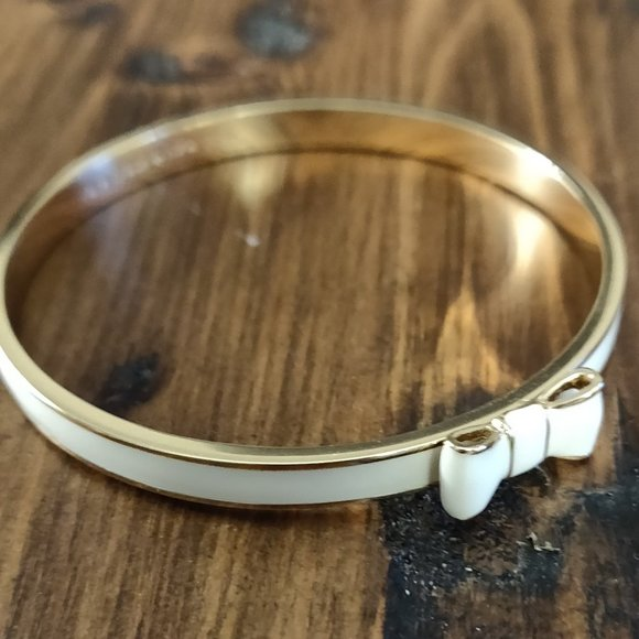 Kate Spade white and gold bow bangle